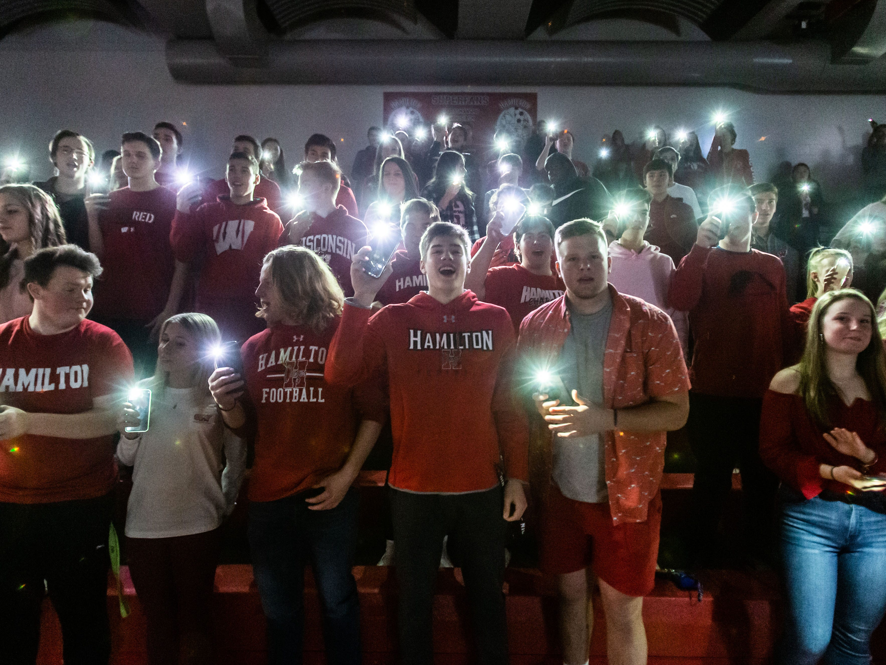 Hamilton students light up the field house as their players are announced for the game at home against Germantown on Thursday, Feb. 14, 2019.