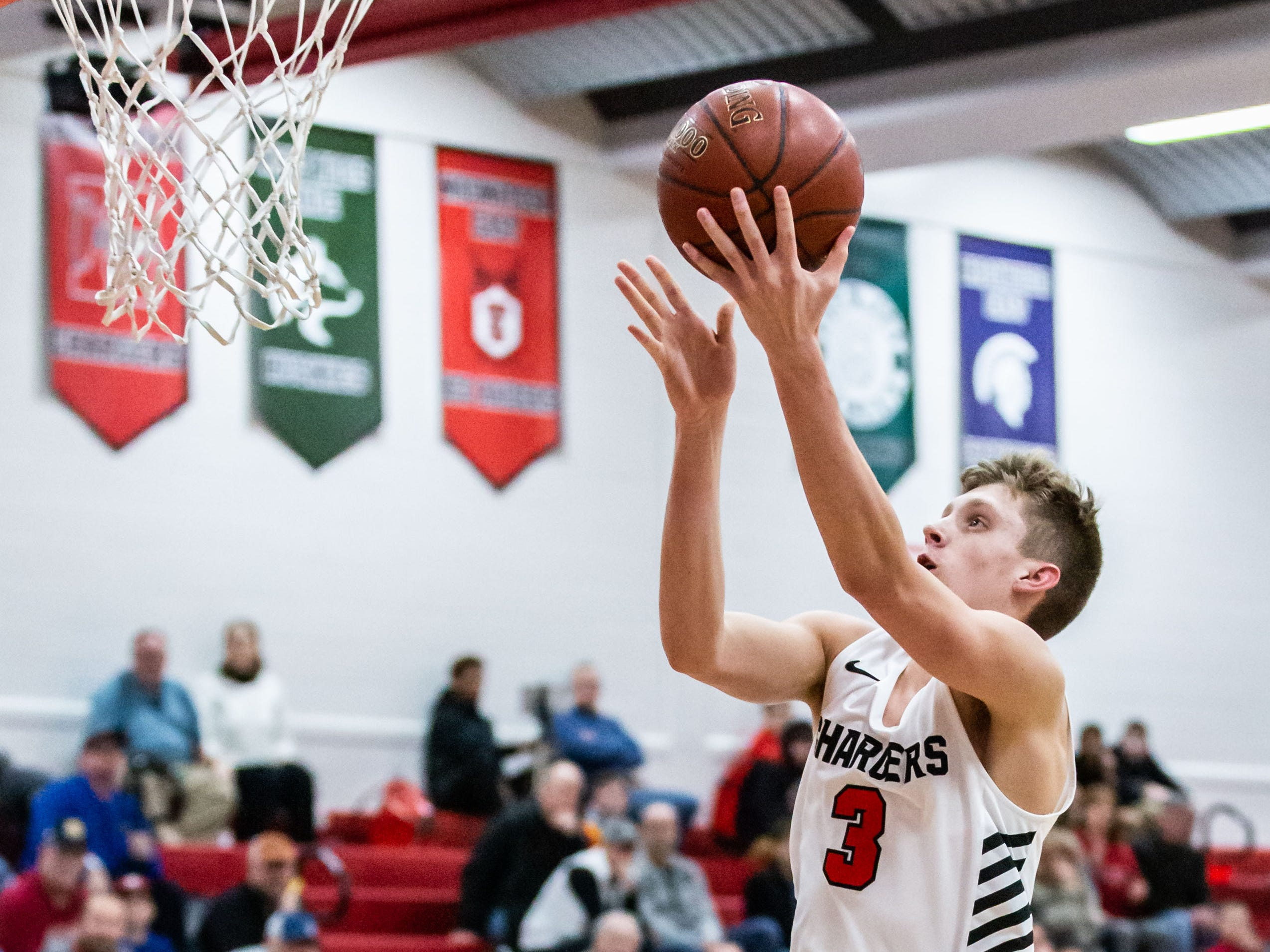 Hamilton's Tyler Ellingson (3) drives in for a layup during the game at home against Germantown on Thursday, Feb. 14, 2019.
