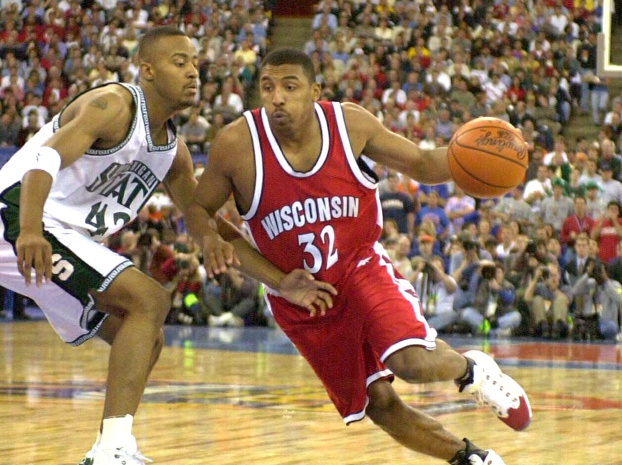 The Wisconsin Badgers Roy Boone drives the lane against the Spartans Morris Peterson during the first half of the NCAA Final Four game between the Wisconsin Badgers and the Michigan State Spartans at the RCA Dome in Indianapolis, Indiana on April 1, 2000. J