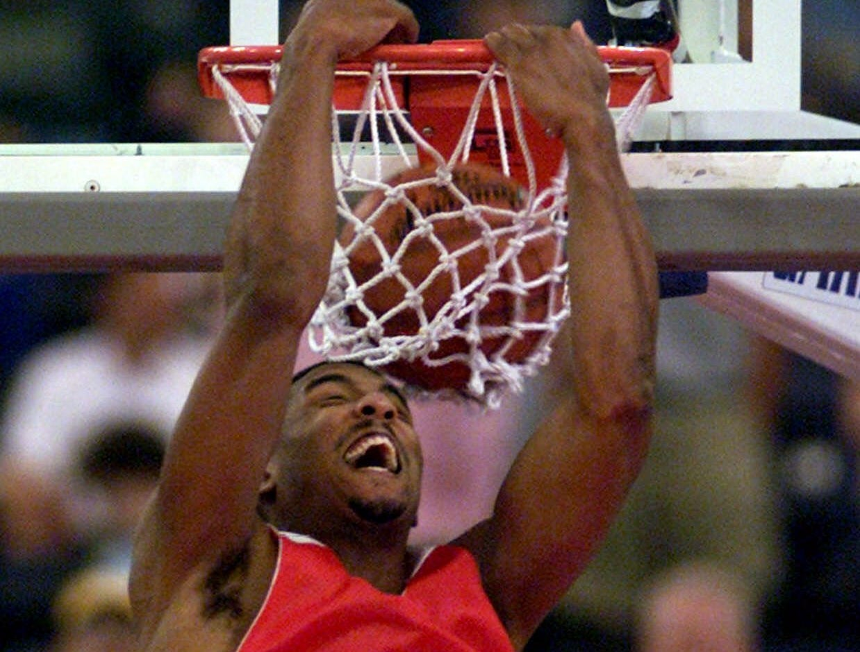 University of Wisconsin guard Roy Boone dunks during practice on Friday, March 31, 2000, at the RCA Dome in Indianapolis.