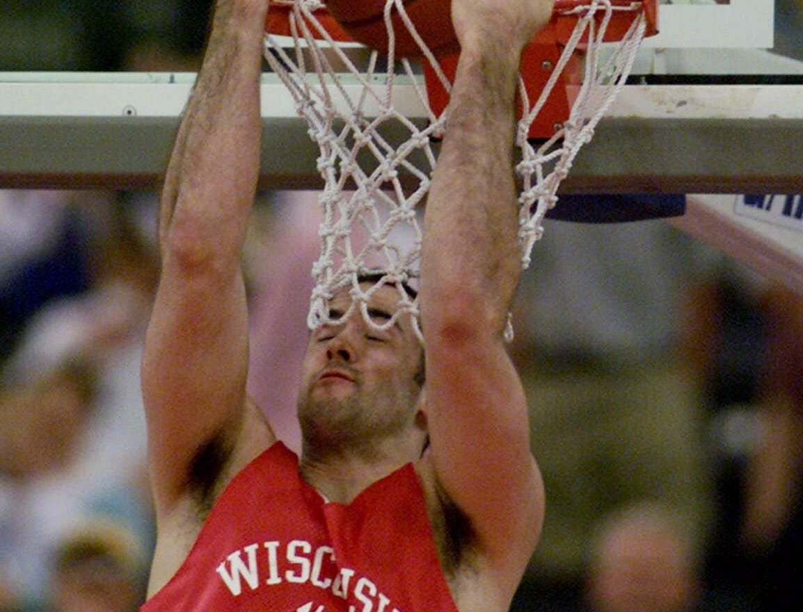 University of Wisconsin forward Charlie Wills dunks during a practice session at the RCA Dome in Indianapolis, Friday, March 31, 2000. Wills is from Angola, Ind.
