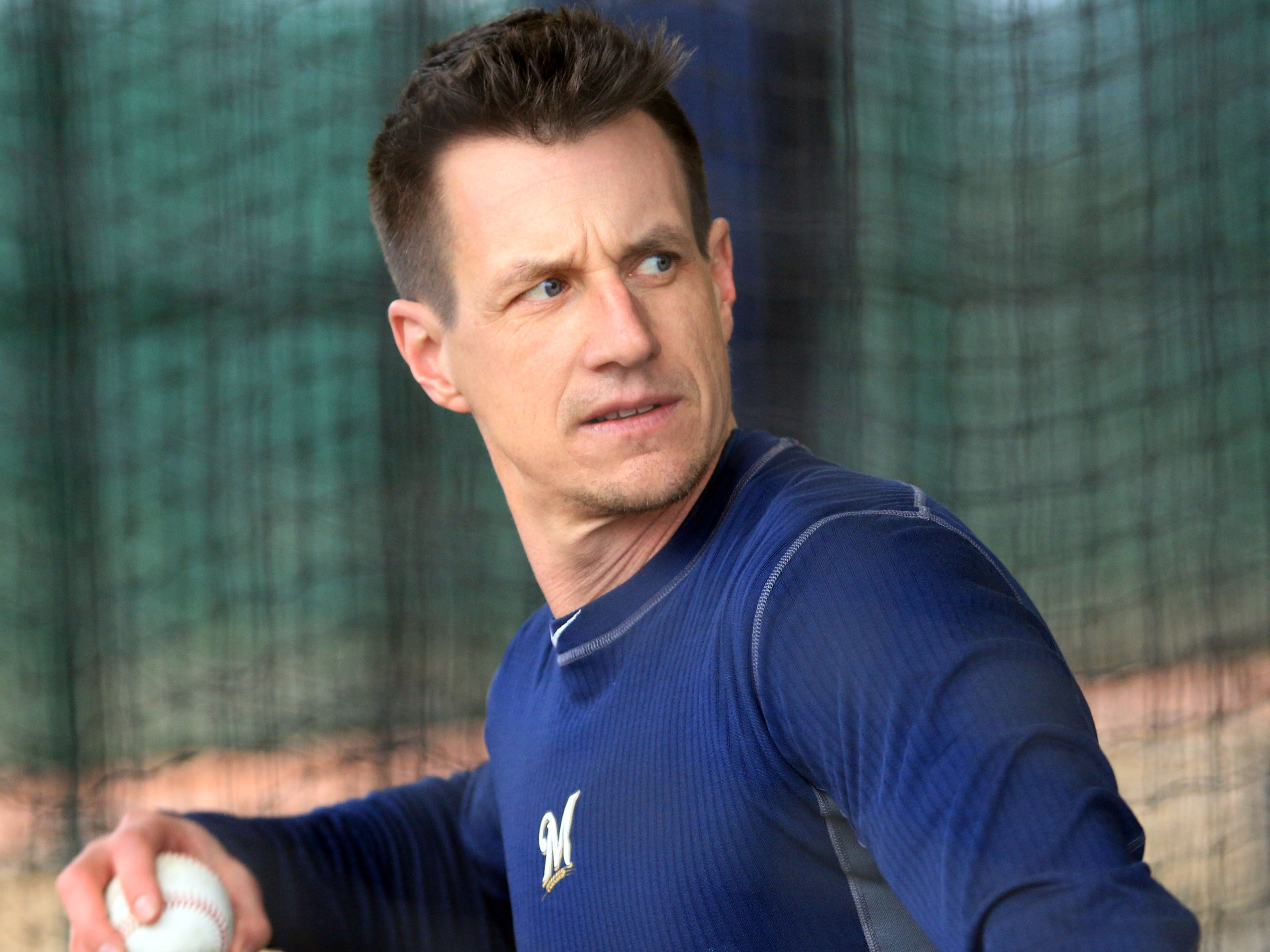 Brewers manager Craig Counsell throws batting practice Thursday.