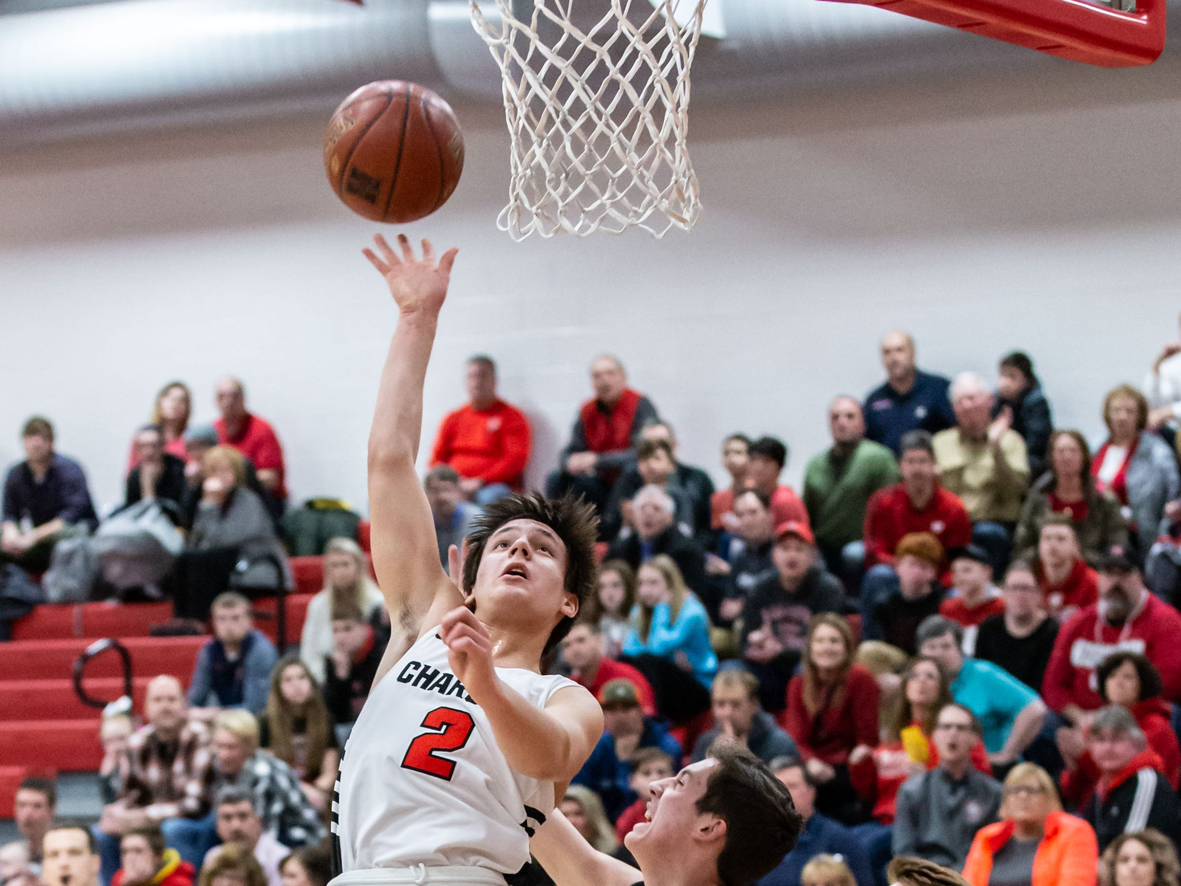 Hamilton's Tanner Resch (2) tips in his own rebound for two during the game at home against Germantown on Thursday, Feb. 14, 2019.