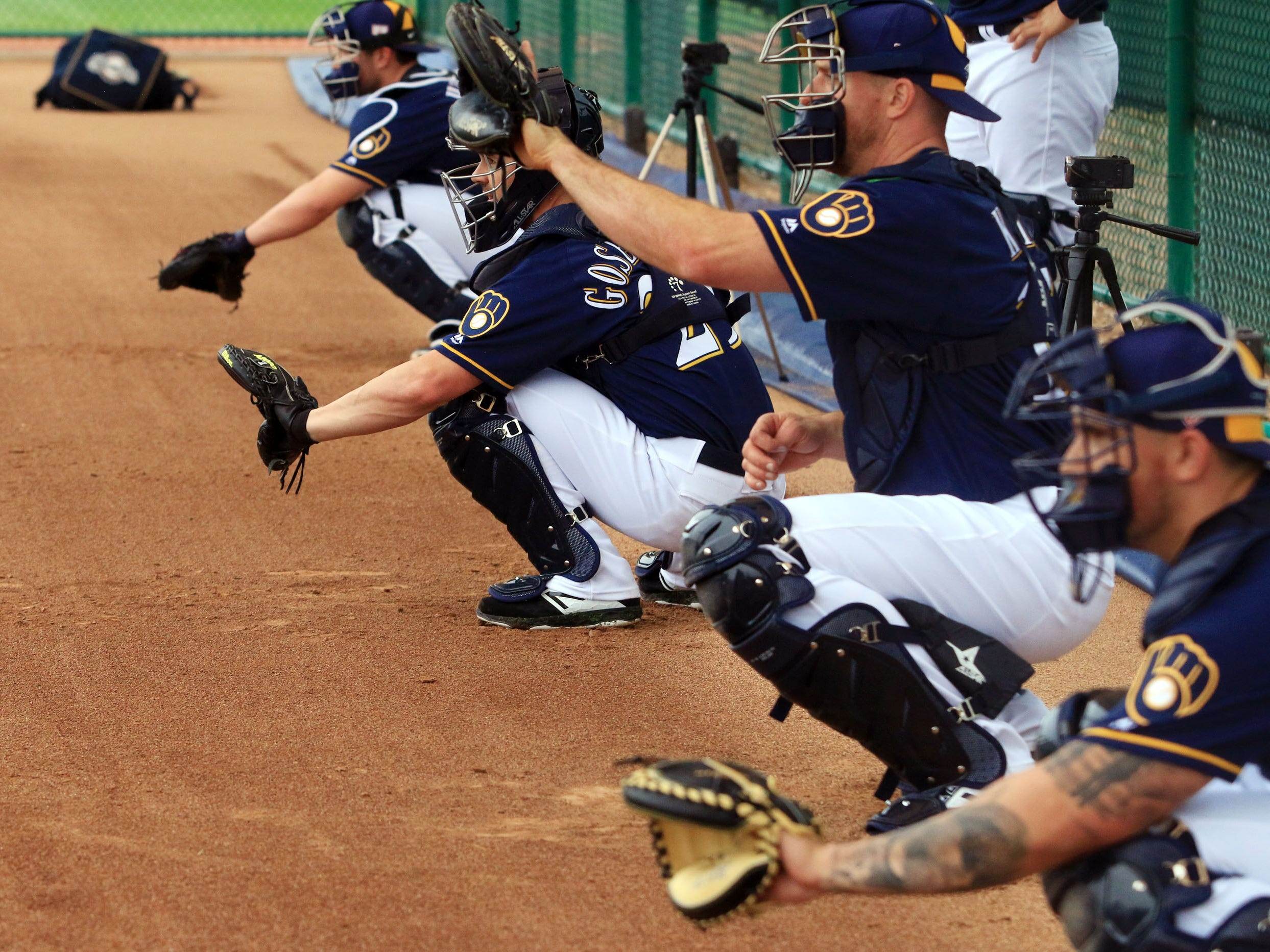 Brewers catchers get work in as pitchers go through throwing sessions on Thursday.