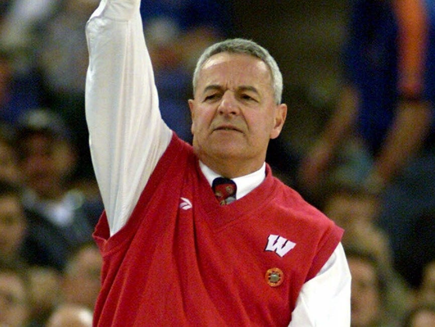 Wisconsin head coach Dick Bennett signals to his team at the end of first half during the national semi-final game of the Final Four against Michigan State University, Saturday, April 1, 2000, at the RCA Dome in Indianapolis.