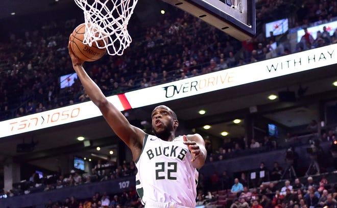 Milwaukee Bucks forward Khris Middleton (22) scores during first-half NBA basketball action in Toronto, Thursday Jan. 31, 2019. (Frank Gunn/The Canadian Press via AP) ORG XMIT: FNG205