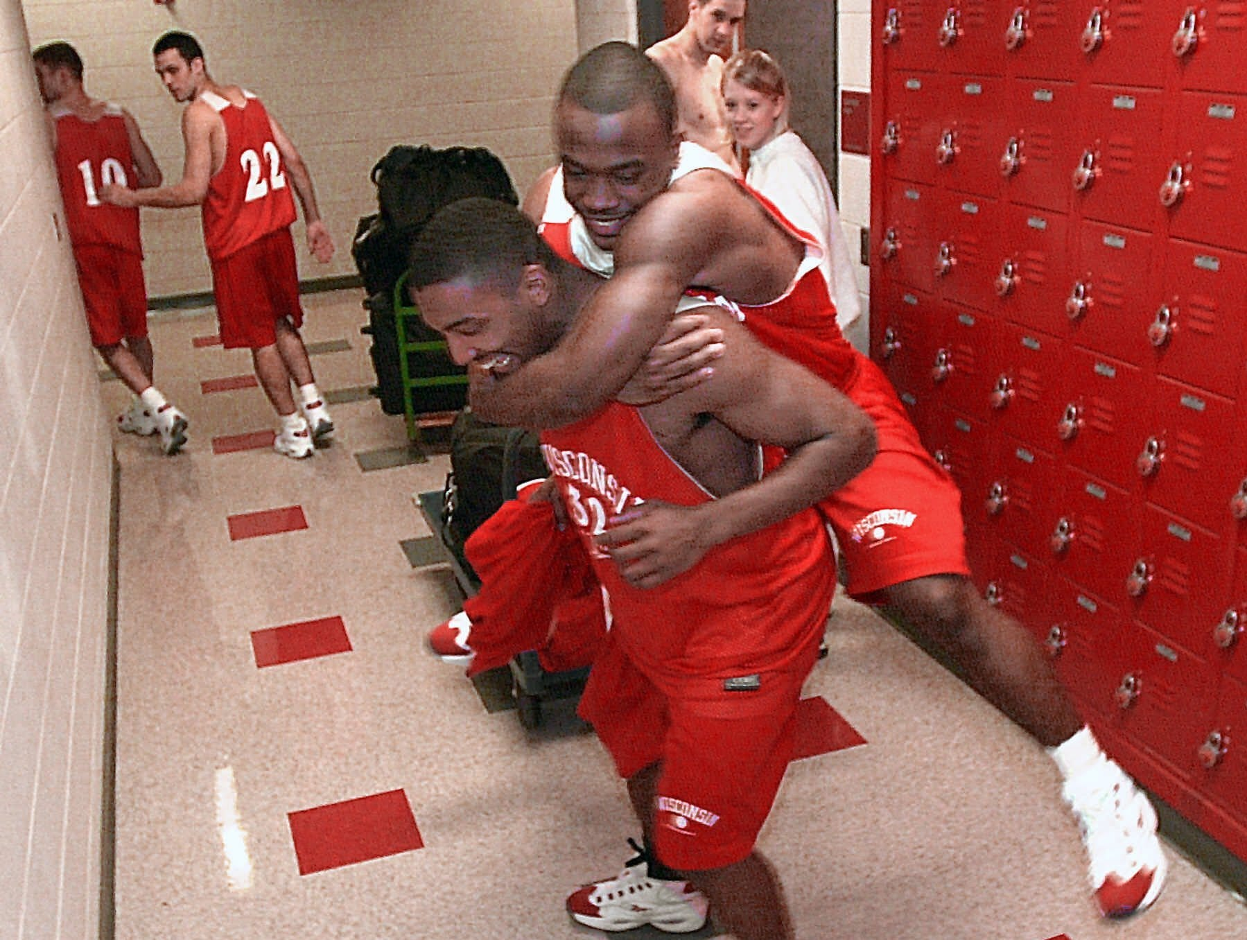 Wisconsin's Ray Boone (32) and Travon Davis have some fun in the hall after a practice Wednesday, March 29, 2000, in Madison, Wis. The team left for Indianapolis after practice, to play Michigan State in the semifinals of the NCAA Final Four.