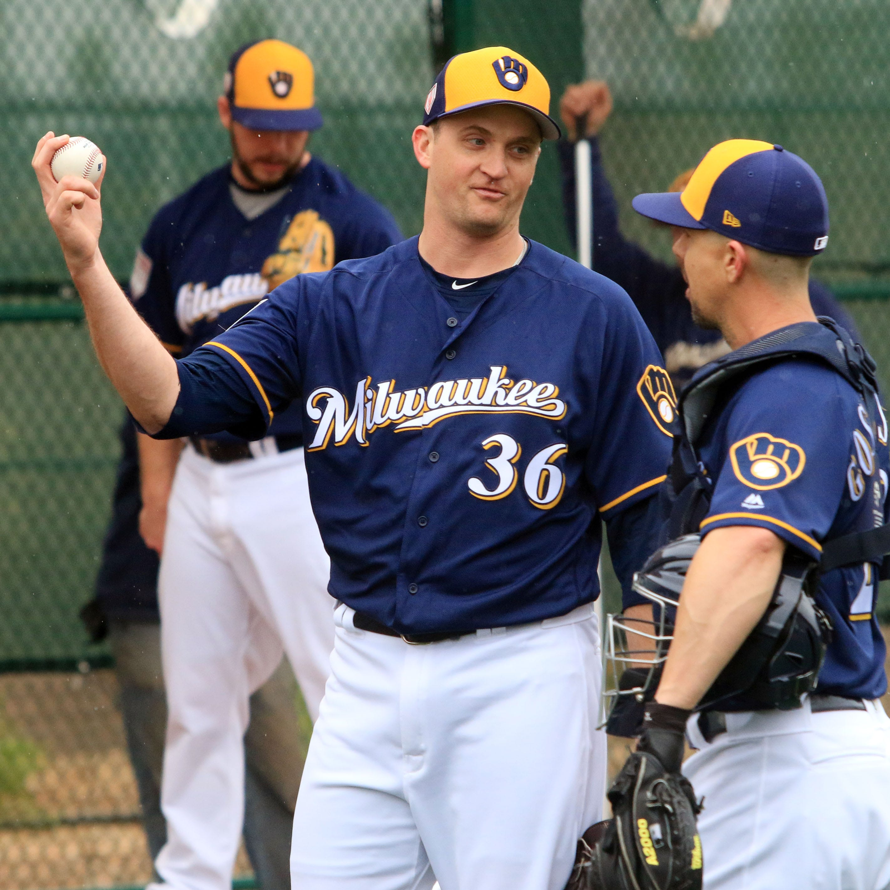 Brewers relief pitcher Jake Petricka  talks with...