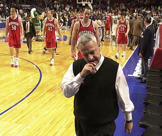 Big Ten Men Basketball Tournament United Center Chicago Ill 3/11/00 Wisconsin head coach Dick Bennett walks off the court with his team after loosing to Michigan State in a Semi Final game during the Big Ten Mens Basketball Tournament at the United Center in Chicago.