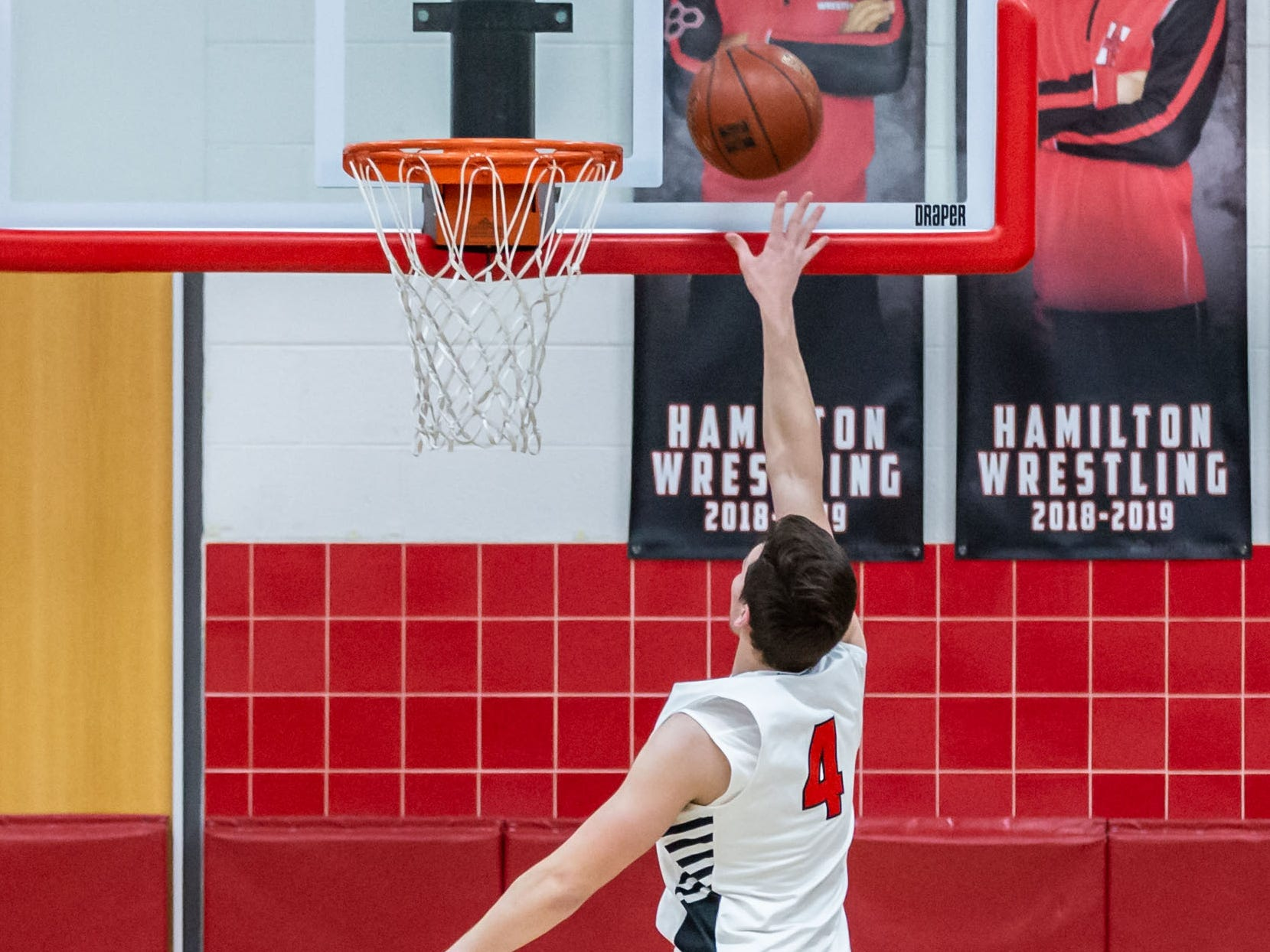 Hamilton's Lucas Finnessy (4) scores on a layup during the game at home against Germantown on Thursday, Feb. 14, 2019.