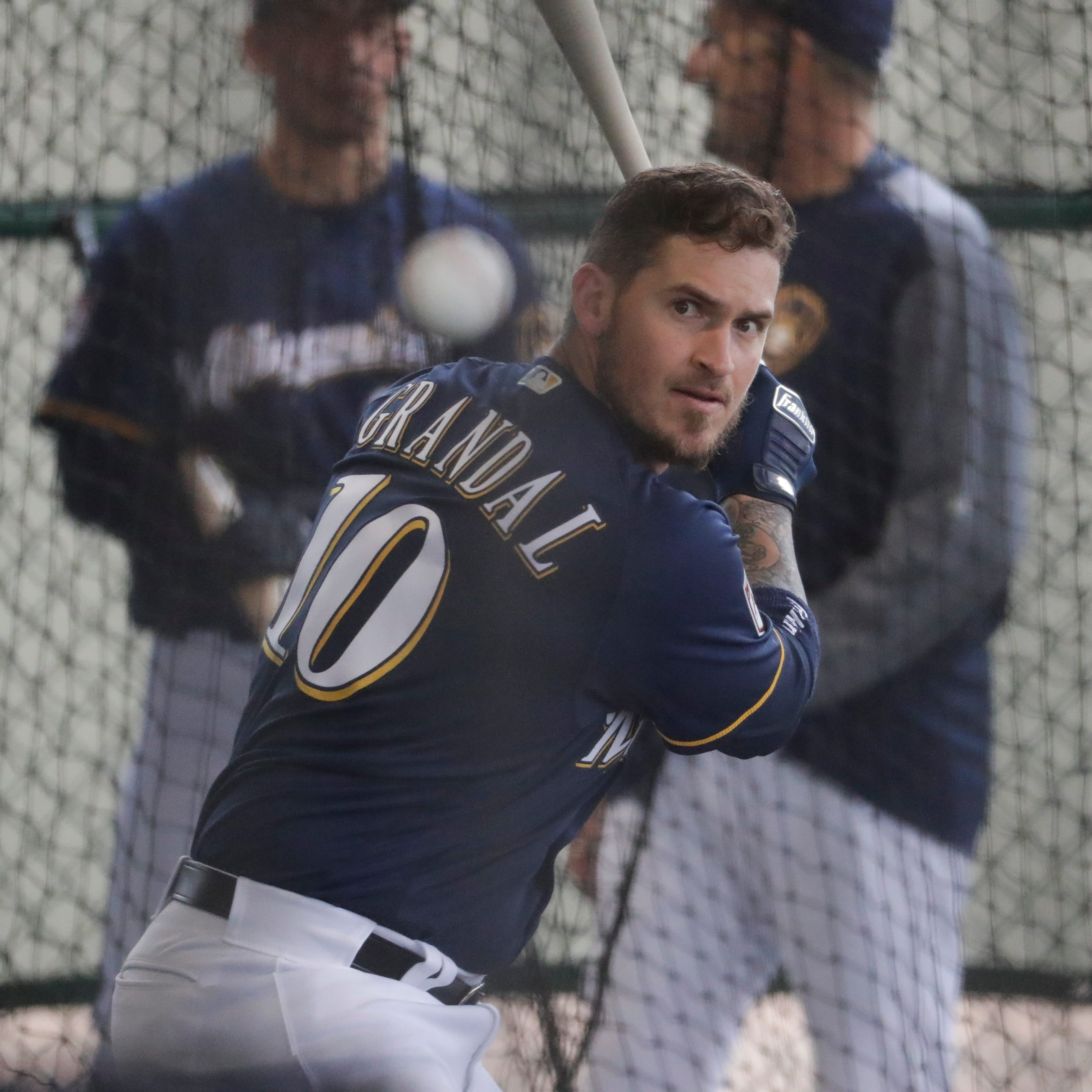 Milwaukee Brewers' Yasmani Grandal hits during a...