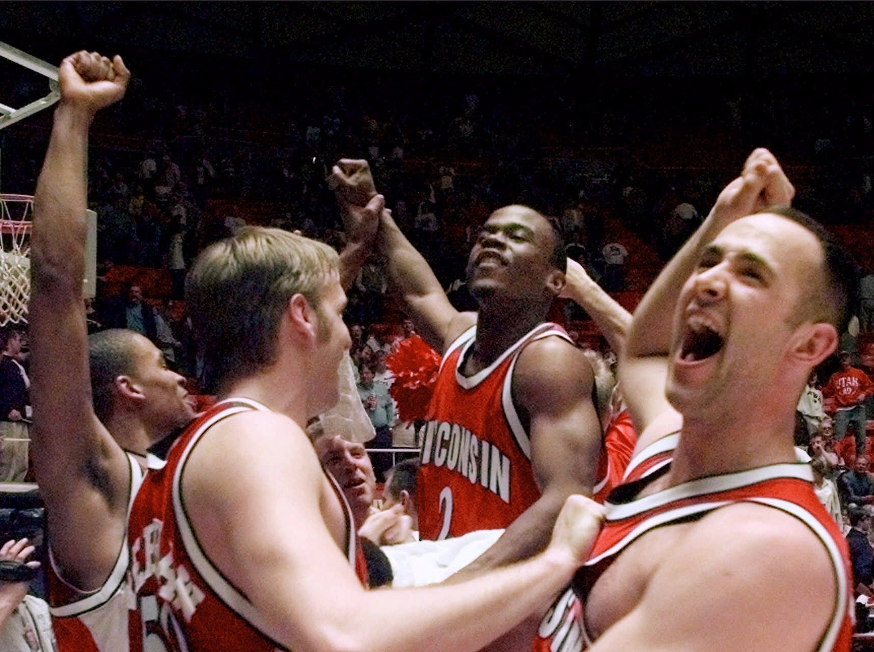 Wisconsin players Mark Vershaw (50) and Charlie Wills, right, grab each other's jersey as the team celebrates its 66-59 upset win over Arizona during the second round of the NCAA West Regionals in Salt Lake City on Saturday, March 18, 2000.