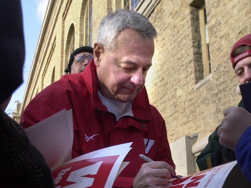 Wisconsin Head Coach Dick Bennett gets mobed after the pep rally for autographs out side of the Uw Field house.