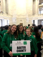 Baxter County 4-H Club membersCaitlyn King (from left), Quinn Hodges and Kelsey Roach are shown at the4-H Day at the Capital event Tuesday in Little Rock.