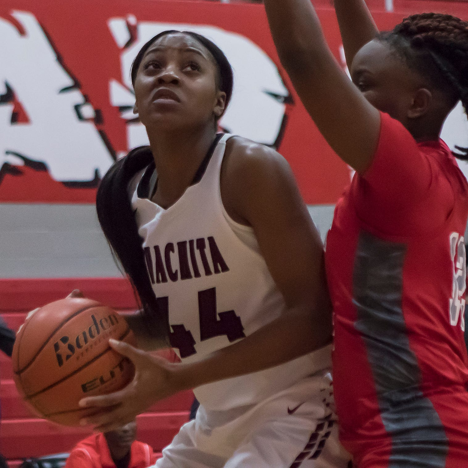 Ouachita's Mahoganie Williams (44) looks to score a basket against West Jefferson's Jada Bowman (12) during the Class 5A playoff game at Ouachita High School on Feb. 14. Ouachita would win the game 71- 25 to advance to the next round.