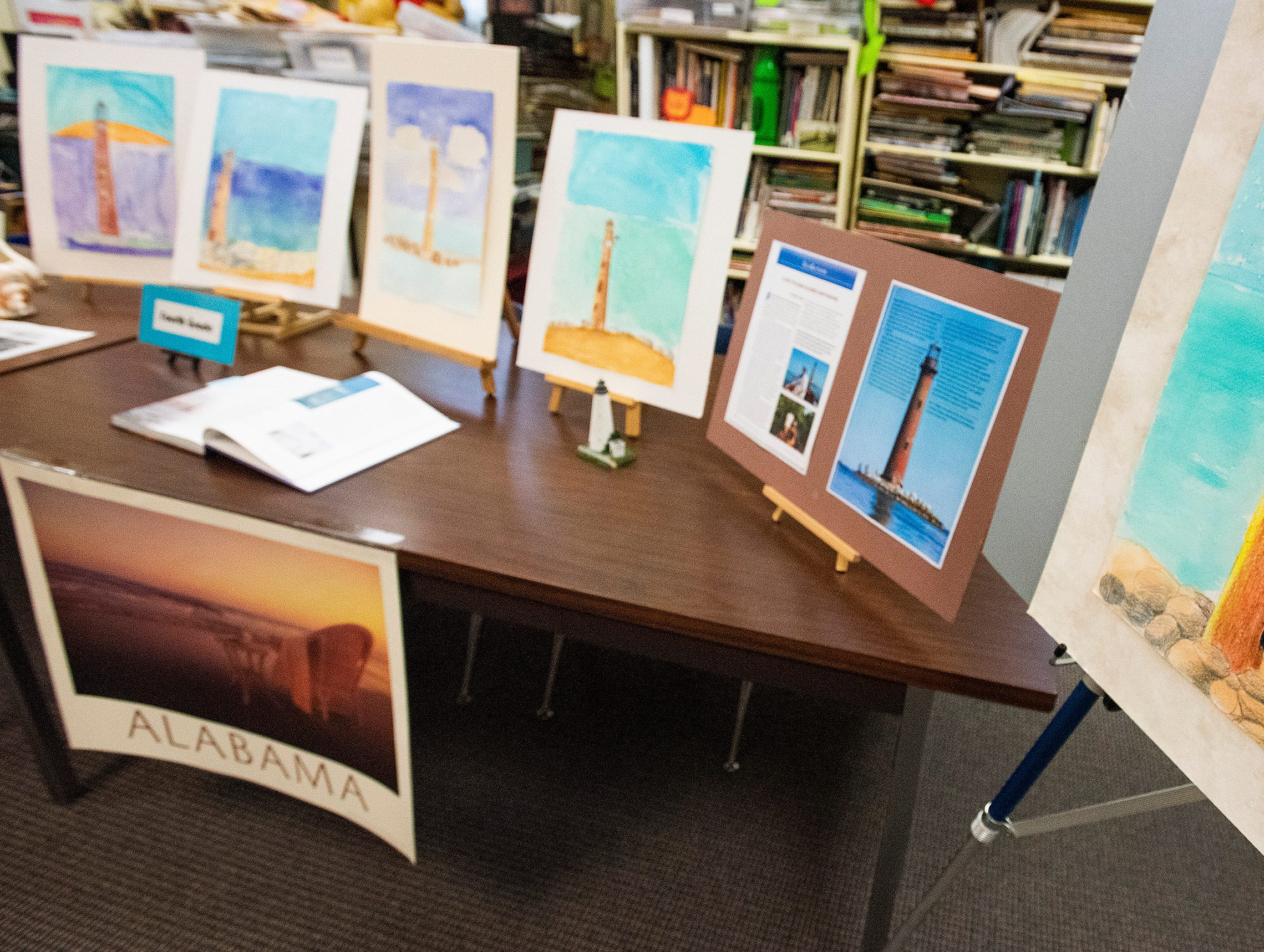 Students artwork representing Alabama is displayed while the school celebrates the Alabama Bicentennial at Holy Cross Episcopal School in Montgomery, Ala., on Friday February 15, 2019.