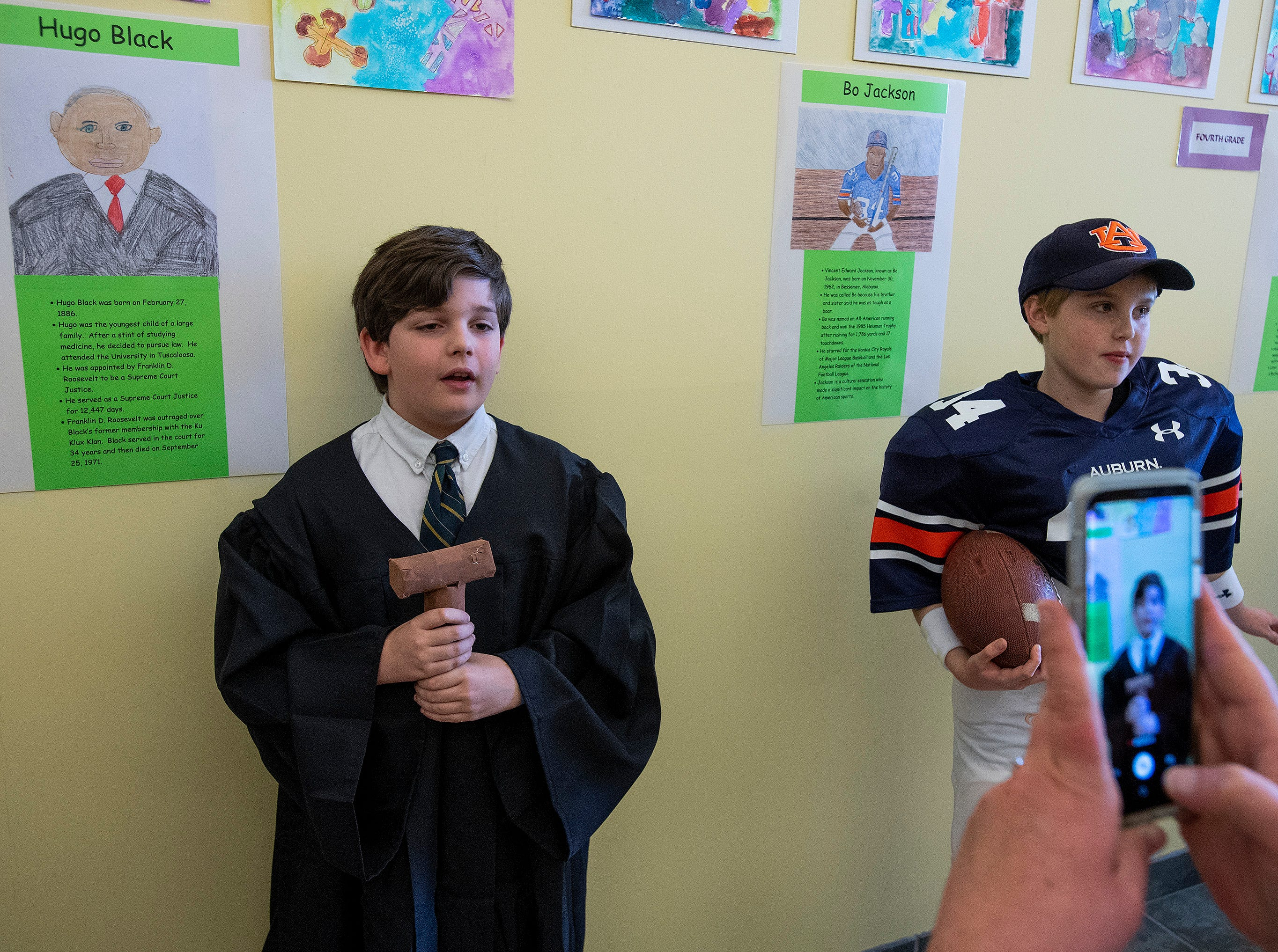 Cullen Stuart plays Hugo Black and Steadman Meadows plays Bo Jackson as students portray Alabamians in their Alabama Bicentennial Wax Museum, telling the stories of their characters to visitors, at Holy Cross Episcopal School in Montgomery, Ala., on Friday February 15, 2019.