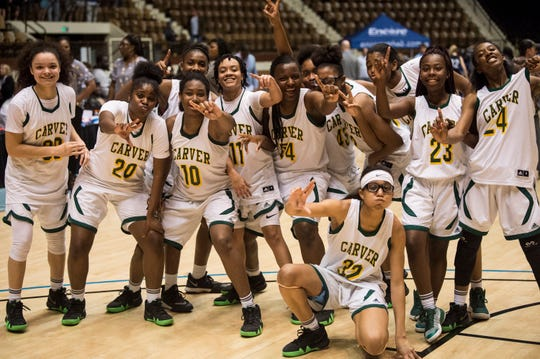 Carver's team poses for a picture after their win during the Class 6A Southeast Regional semifinals in Montgomery, Ala., on Friday, Feb. 15, 2019. Carver defeated Chelsea 69-33.