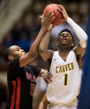Carver forward Jaykwon Walton (1) goes up for a layup during the Class 6A Southeast Regional semifinals in Montgomery, Ala., on Friday, Feb. 15, 2019. Carver defeats Opelika 44-41.