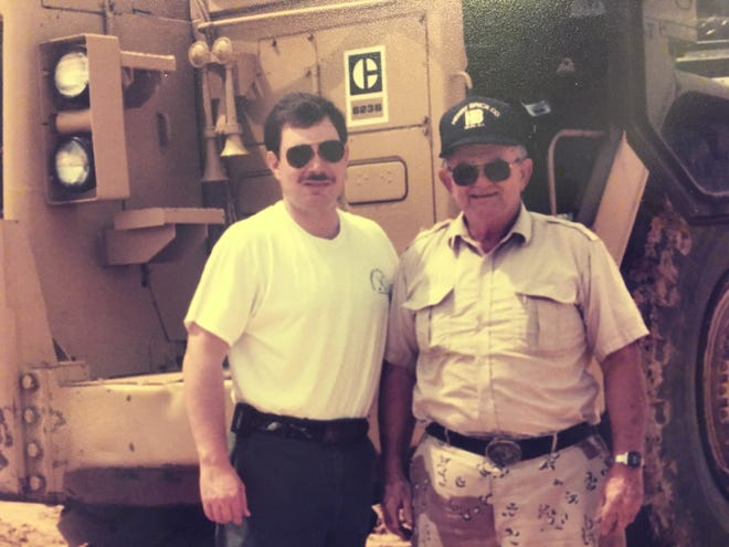 About 1996, I was visiting Dad on the job at Henry Brick's pit. Was I ever that skinny? A copy of this picture hangs in my study at home, and at the office.