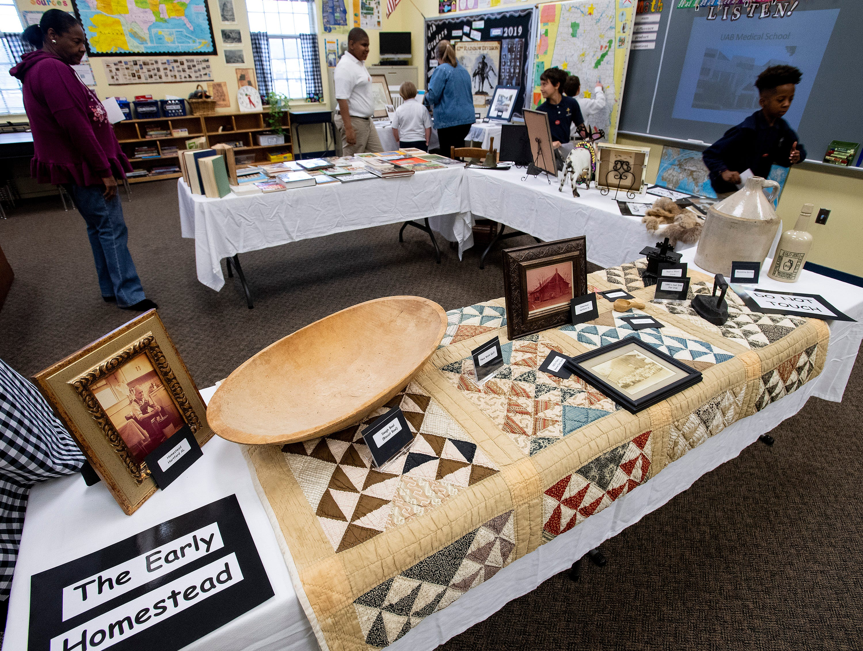 A display of artifacts is viewed while the Holy Cross Episcopal School celebrates the Alabama Bicentennial at the school in Montgomery, Ala., on Friday February 15, 2019.