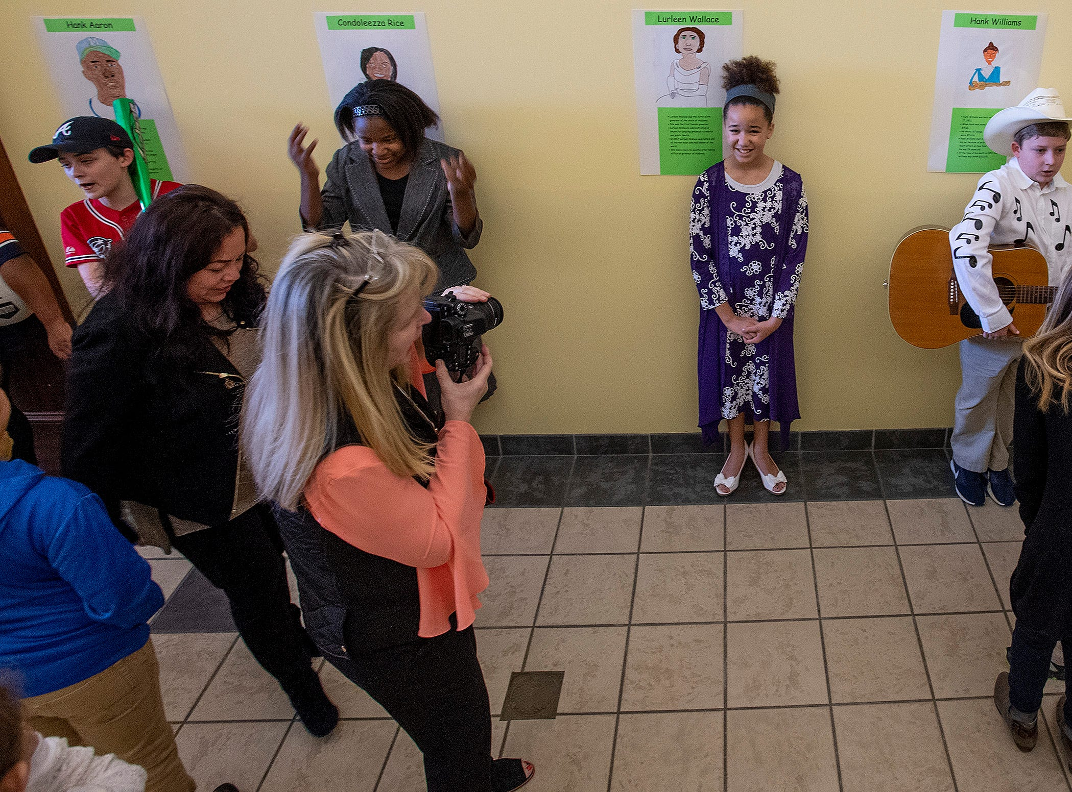 Emilee Alexander has her photo taken while playing Lurleen Wallace as students portray Alabamians in their Alabama Bicentennial Wax Museum, telling the stories of their characters to visitors, at Holy Cross Episcopal School in Montgomery, Ala., on Friday February 15, 2019.