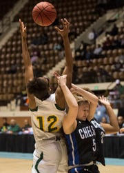 Carver's Mya Barnes (12) grabs a rebound over Chelsea's Suzanne Ridgway (5) during the Class 6A Southeast Regional semifinals in Montgomery, Ala., on Friday, Feb. 15, 2019. Carver defeated Chelsea 69-33.