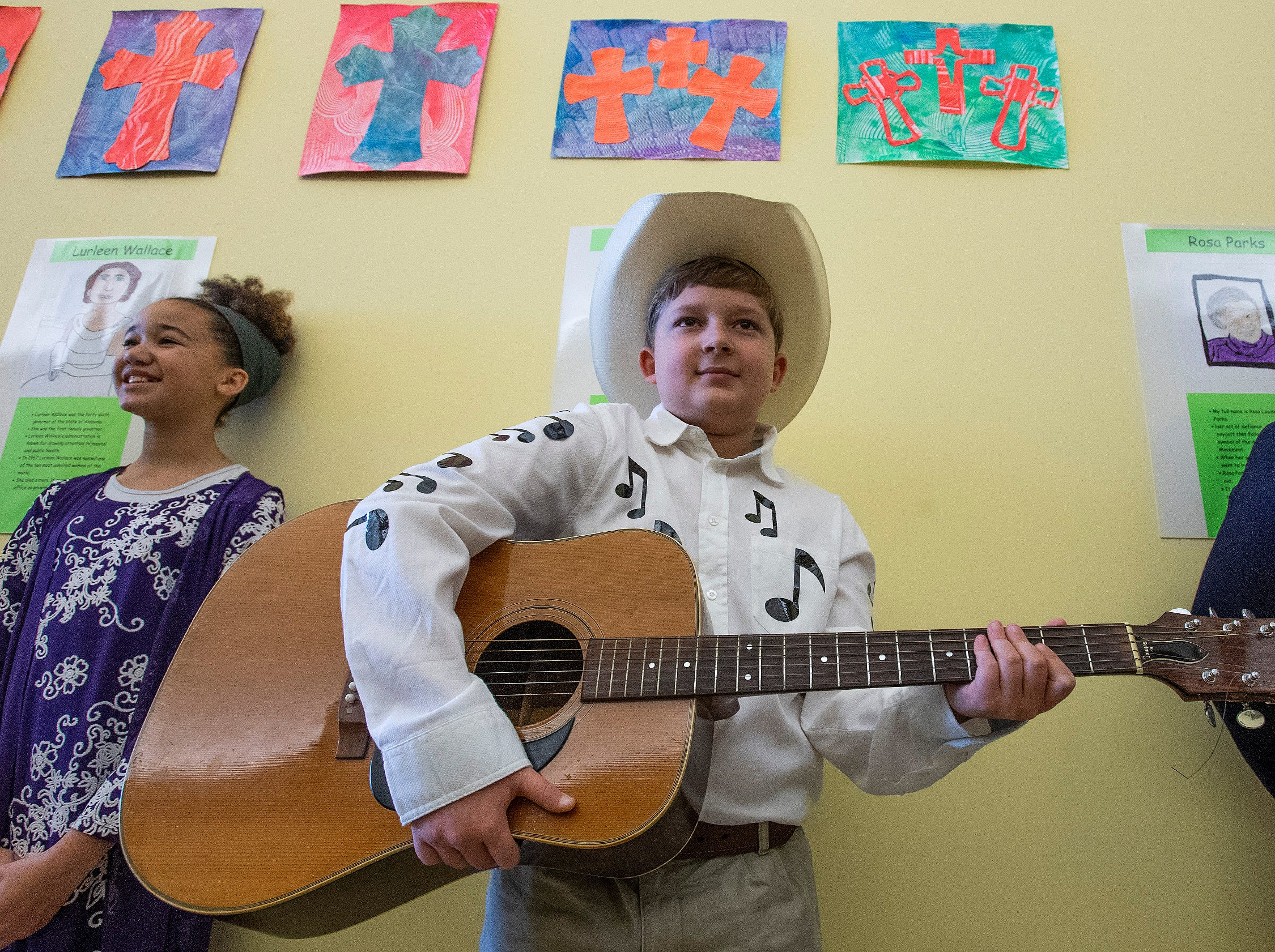 Emilee Alexander plays Lurleen Wallace, Andrew Peavy plays Hank Williams and Hayley Whetstone plays Rosa Parks as students portray Alabamians in their Alabama Bicentennial Wax Museum, telling the stories of their characters to visitors, at Holy Cross Episcopal School in Montgomery, Ala., on Friday February 15, 2019.