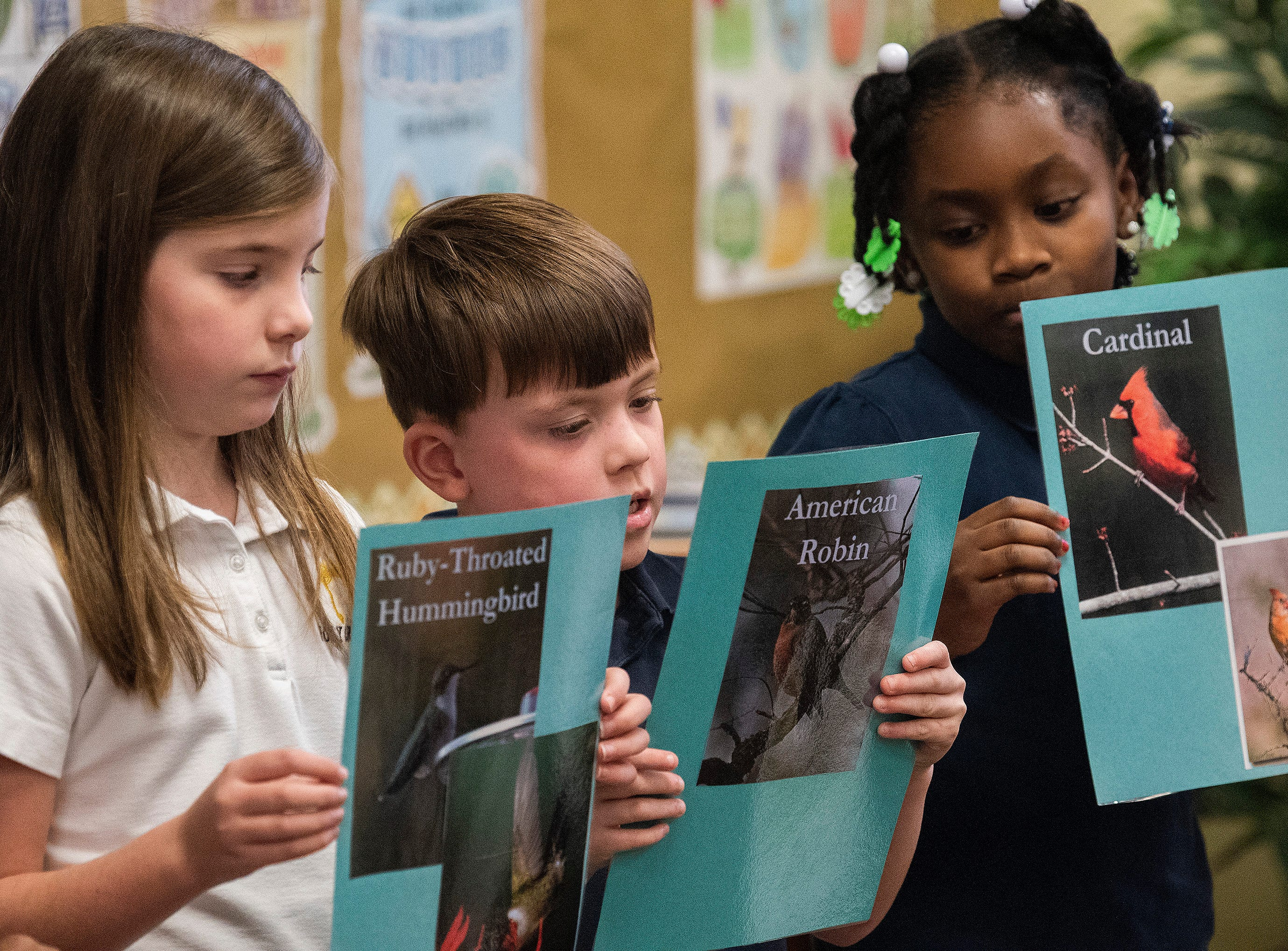 Students give presentations on Alabama birds while celebrating the Alabama Bicentennial at Holy Cross Episcopal School in Montgomery, Ala., on Friday February 15, 2019.