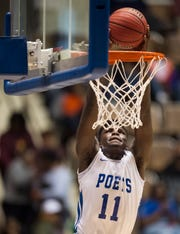 Lanier's Antwan Burnett (11) throws down a fast break dunk during the Class 6A Southeast Regional semifinals in Montgomery, Ala., on Friday, Feb. 15, 2019. Lanier defeated Helena 54-37.