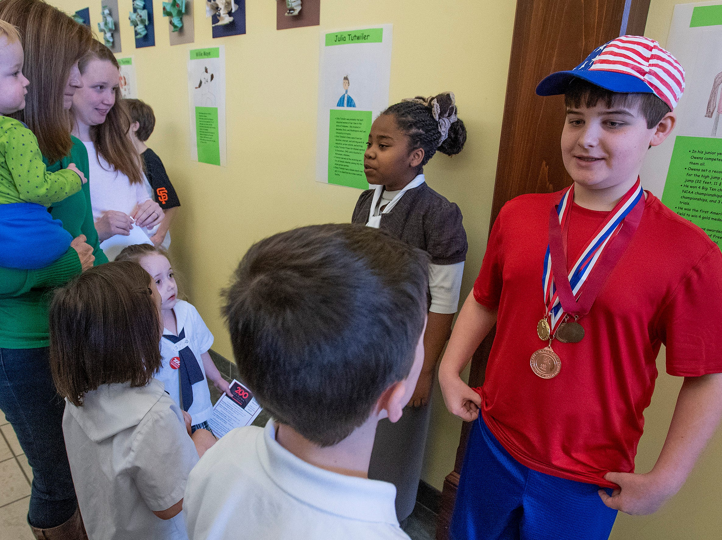 Sanai Burton plays Julia Tutwiler and Gabe Krause plays Jesse Owens as students portray Alabamians in their Alabama Bicentennial Wax Museum, telling the stories of their characters to visitors, at Holy Cross Episcopal School in Montgomery, Ala., on Friday February 15, 2019.