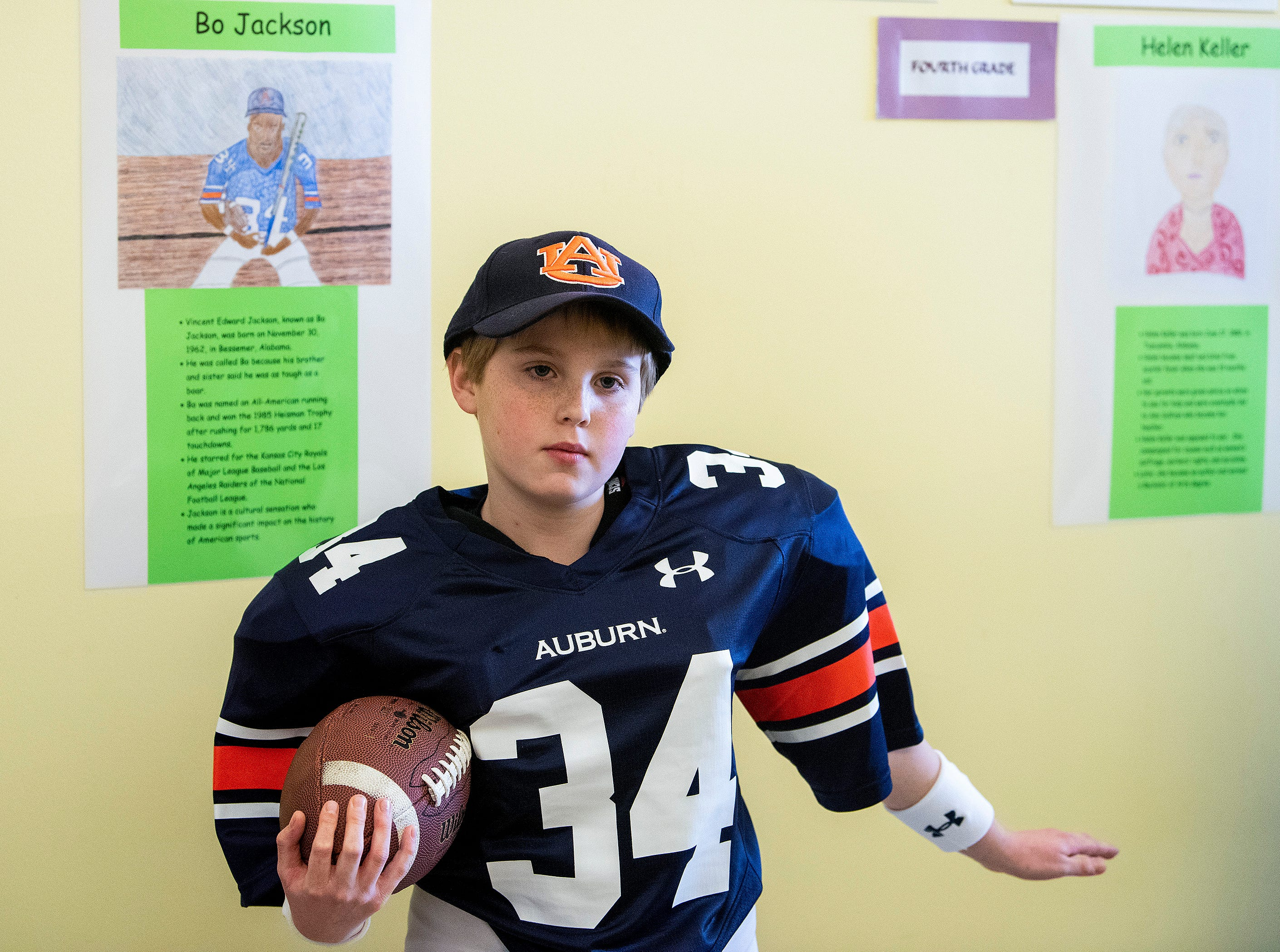 Steadman Meadows plays Bo Jackson as students portray Alabamians in their Alabama Bicentennial Wax Museum, telling the stories of their characters to visitors, at Holy Cross Episcopal School in Montgomery, Ala., on Friday February 15, 2019.