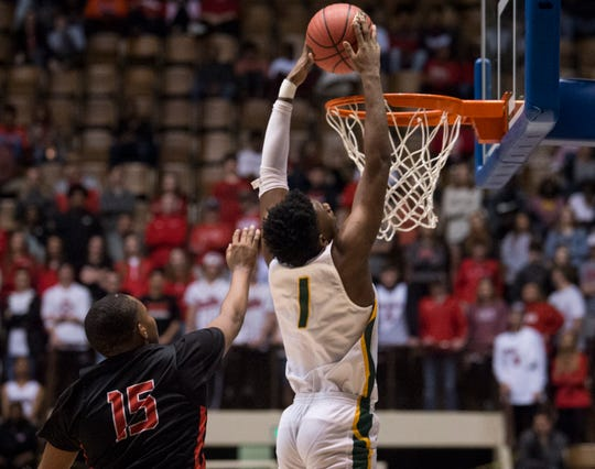 Carver forward Jaykwon Walton (1) throws down a fast break dunk during the Class 6A Southeast Regional semifinals in Montgomery, Ala., on Friday, Feb. 15, 2019. Opelika leads Carver 26-19 at halftime.