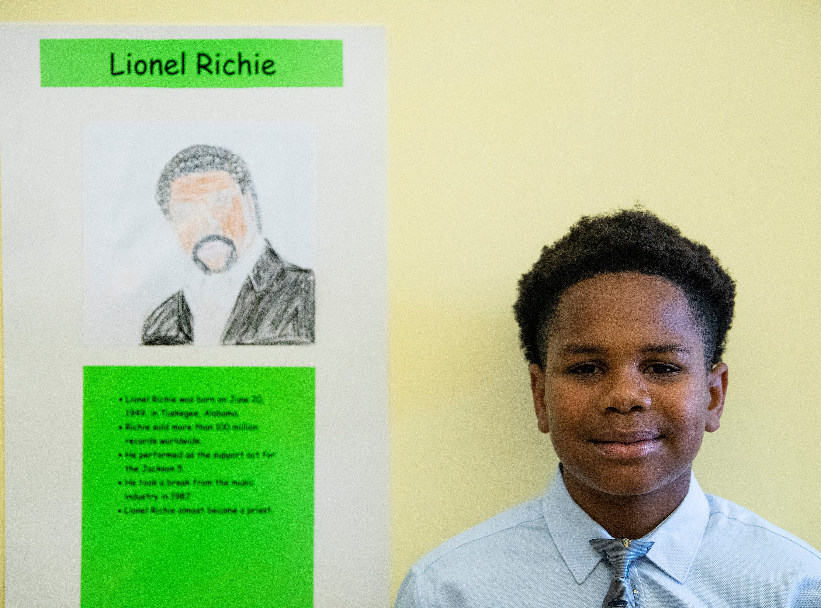 Broderick Williams plays Lionel Ritchie as students portray Alabamians in their Alabama Bicentennial Wax Museum, telling the stories of their characters to visitors, at Holy Cross Episcopal School in Montgomery, Ala., on Friday February 15, 2019.
