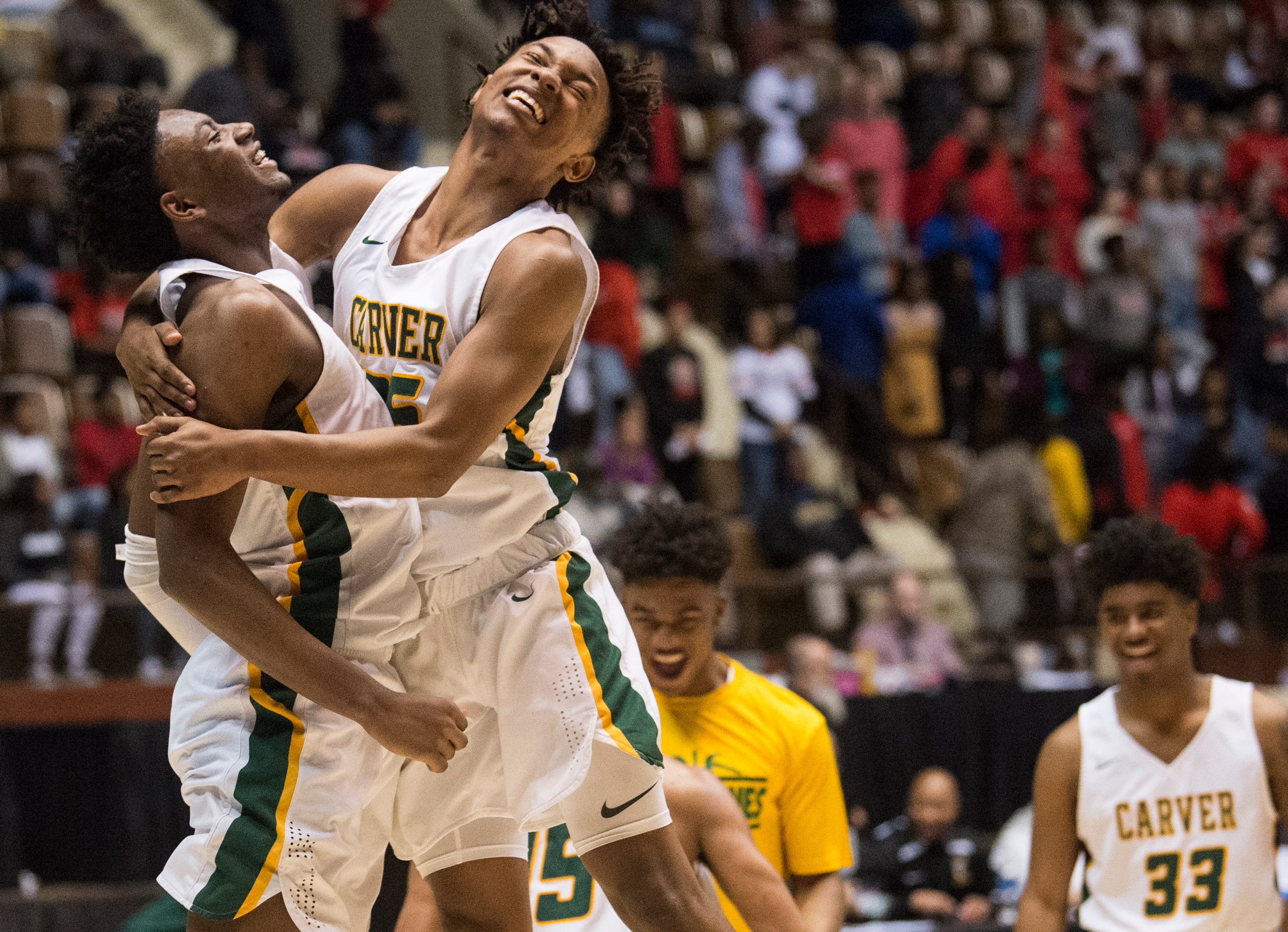 Carver's Jaykwon Walton (1) and Juwon Gaston (25) celebrate after the game during the Class 6A Southeast Regional semifinals in Montgomery, Ala., on Friday, Feb. 15, 2019. Carver defeats Opelika 44-41.