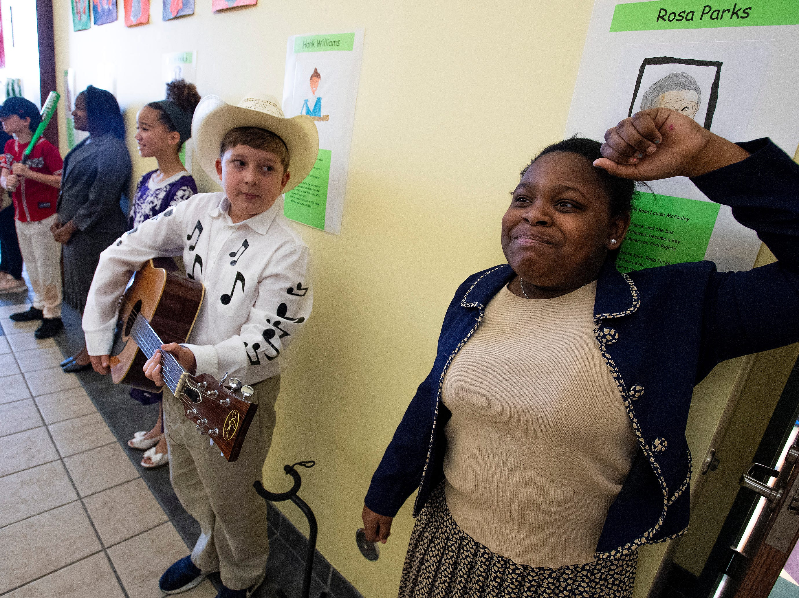 Hayley Whetstone plays Rosa Parks and Andrew Peavy plays Hank Williams as students portray Alabamians in their Alabama Bicentennial Wax Museum, telling the stories of their characters to visitors, at Holy Cross Episcopal School in Montgomery, Ala., on Friday February 15, 2019.