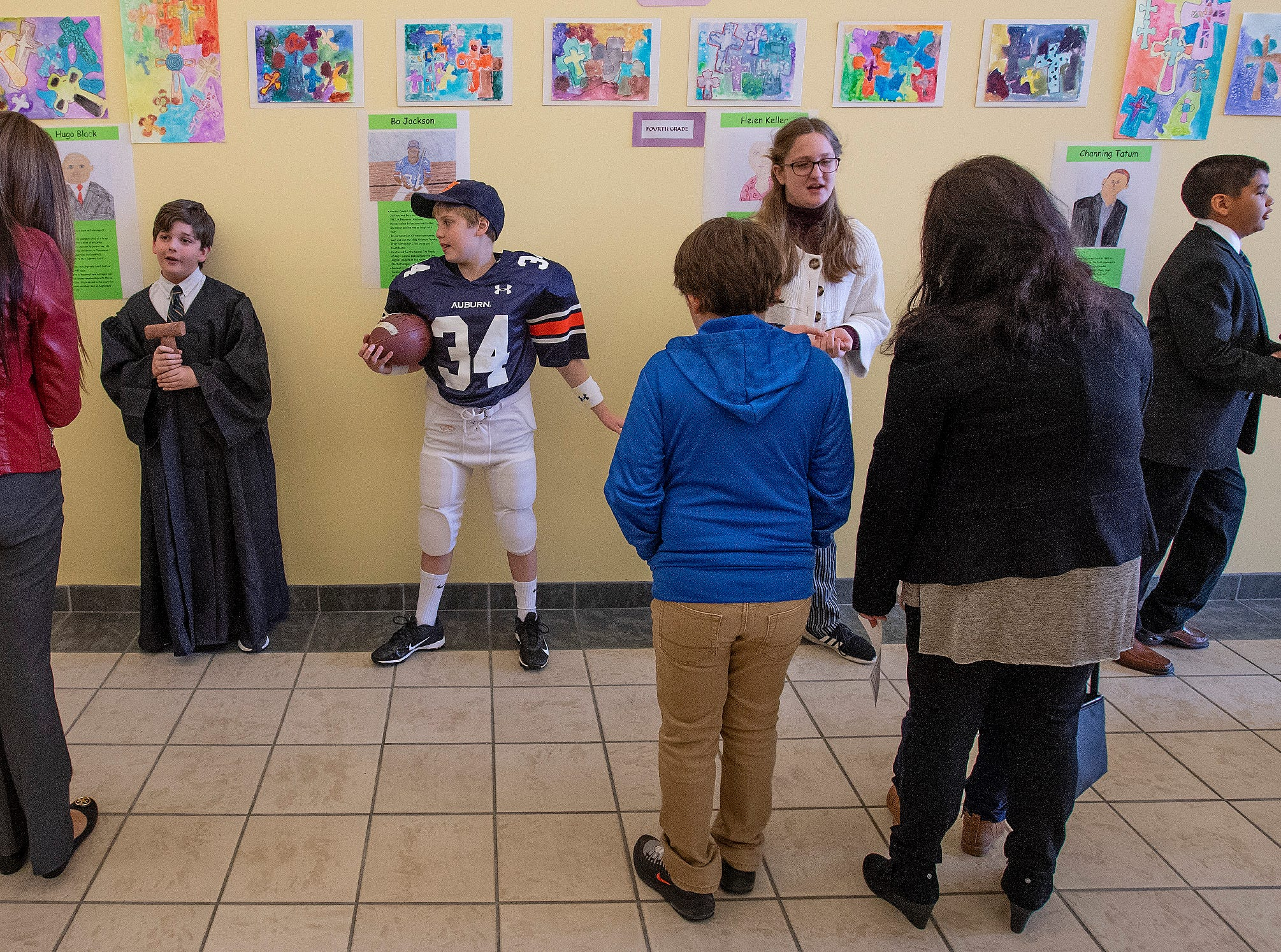 Fifth and sixth grade students portray Alabamians in their Alabama Bicentennial Wax Museum, telling the stories of their characters to visitors, at Holy Cross Episcopal School in Montgomery, Ala., on Friday February 15, 2019.