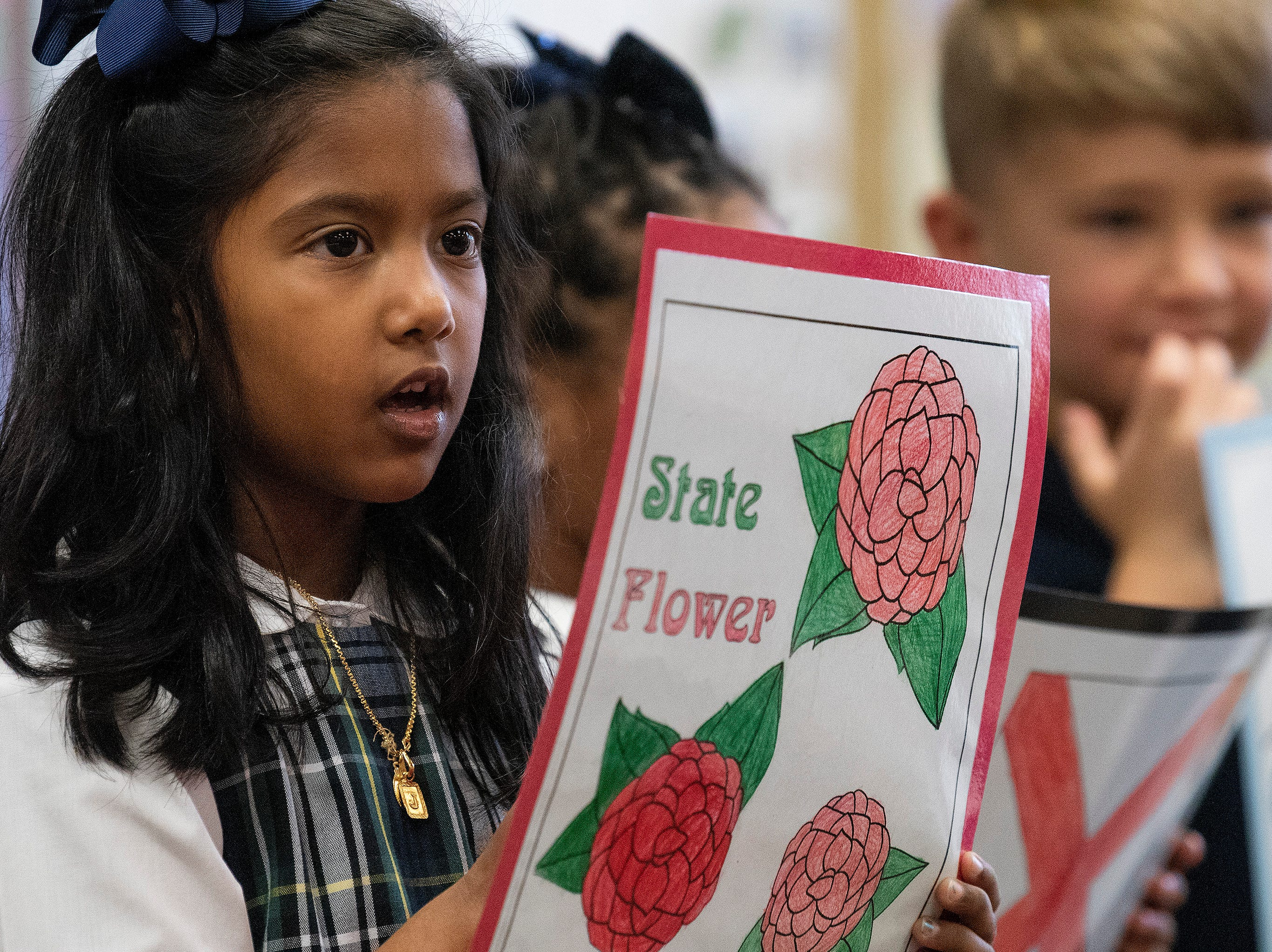 Students give presentations on Alabama while celebrating the Alabama Bicentennial at Holy Cross Episcopal School in Montgomery, Ala., on Friday February 15, 2019.
