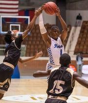 Georgiana's Jaheim Powell grabs the ball against Lanett's Jaquarius Houston in AHSAA Regional basketball action at Garrett Coliseum in Montgomery, Ala., on Thursday February 14, 2019.