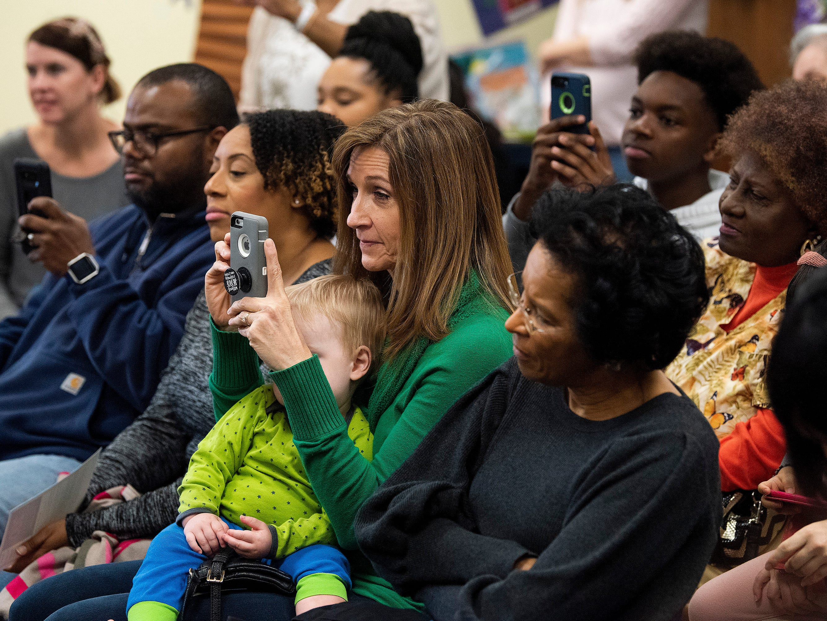 Parents watch as students give presentations on Alabama while celebrating the Alabama Bicentennial at Holy Cross Episcopal School in Montgomery, Ala., on Friday February 15, 2019.