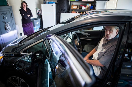 """Muncie locals Rick and Kelly Morris switched to driving an all-electric Chevy Bolt after exclusively driving gas fueled vehicles. Rick said the car charges to """"full tank"""" in about nine hours and had the option of a third-tier charger upgrade that would fully charge the vehicle in one hour."""