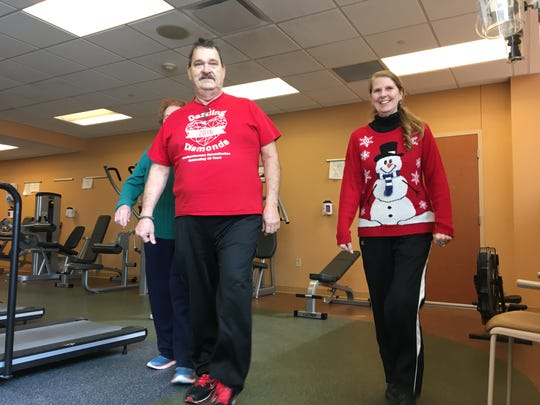 Mike Holmberg and Linda Holmberg walk laps on the track at IU Health Ball Memorial Hospital's cardiac rehab center on Friday, Feb. 15, 2019.