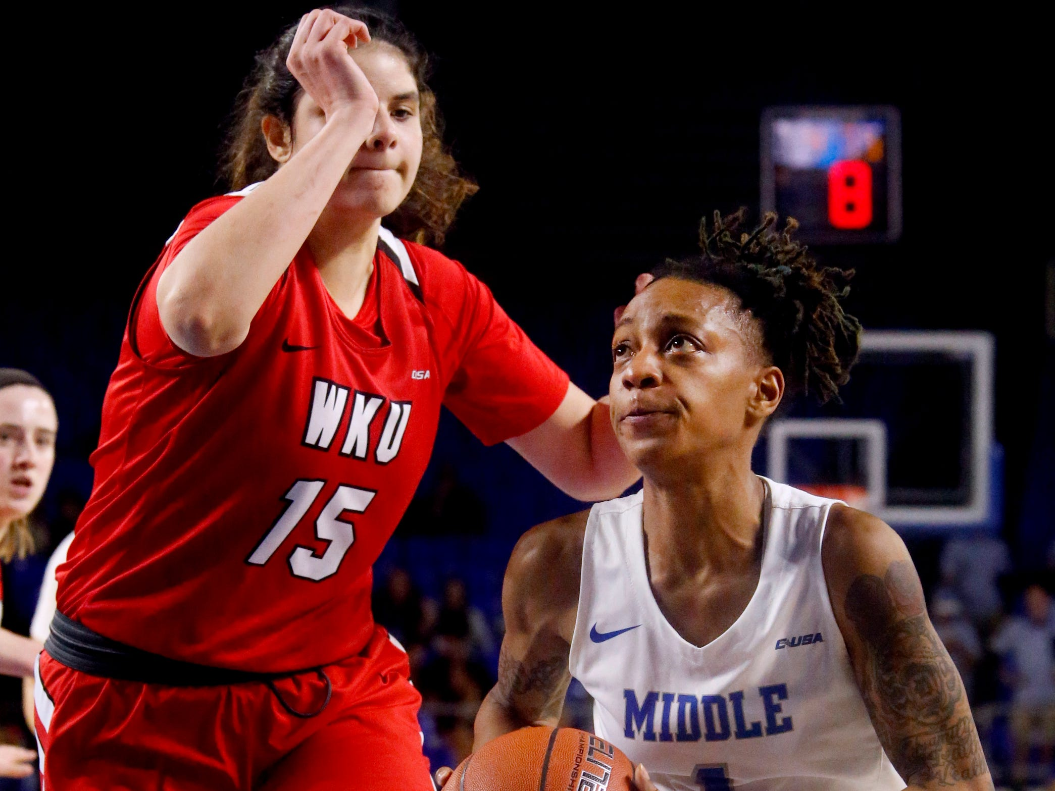 MTSU's guard A'Queen Hayes (1) drives to the basket as Western's forward Raneem Elgedawy (15) moves in to guard her on Thursday, Feb. 14, 2019.