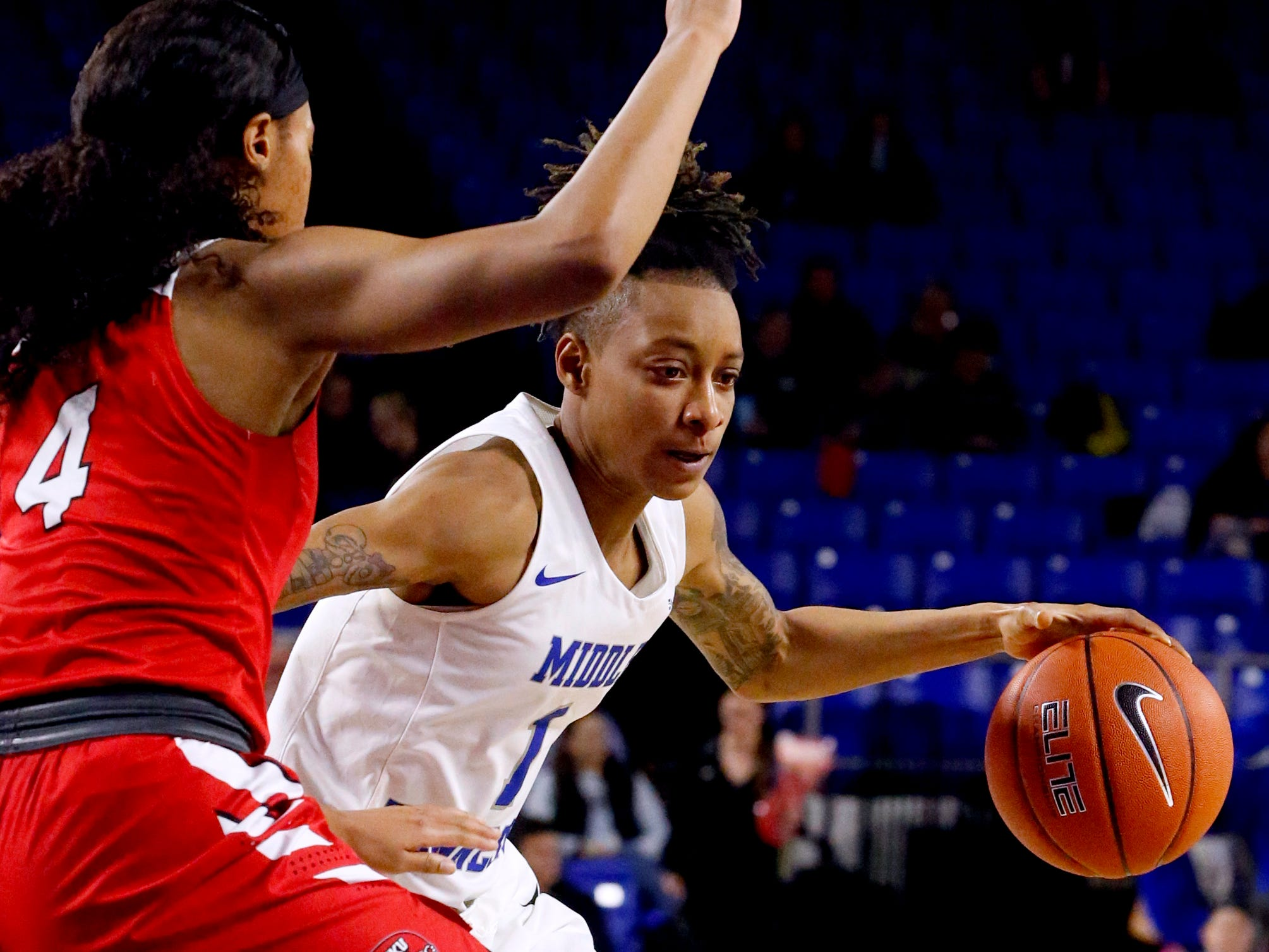 MTSU's guard A'Queen Hayes (1) works her way to the basket as Western's forward Dee Givens (4) guards her on Thursday, Feb. 14, 2019.