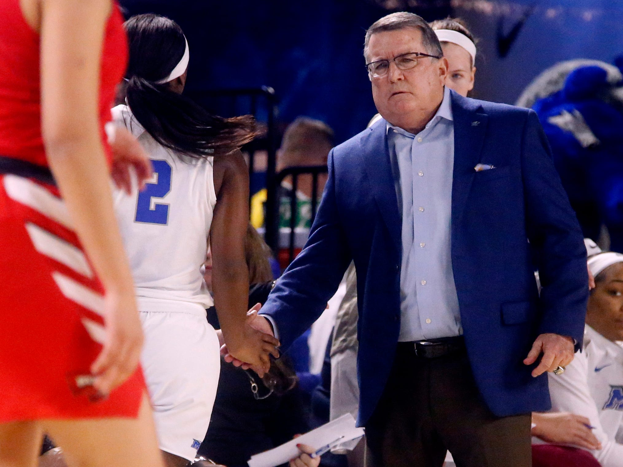 MTSU's head coach Rick Insell on the sidelines as MTSU's guard Taylor Sutton (2) comes out of the game for a play during the game against Western on Thursday, Feb. 14, 2019.