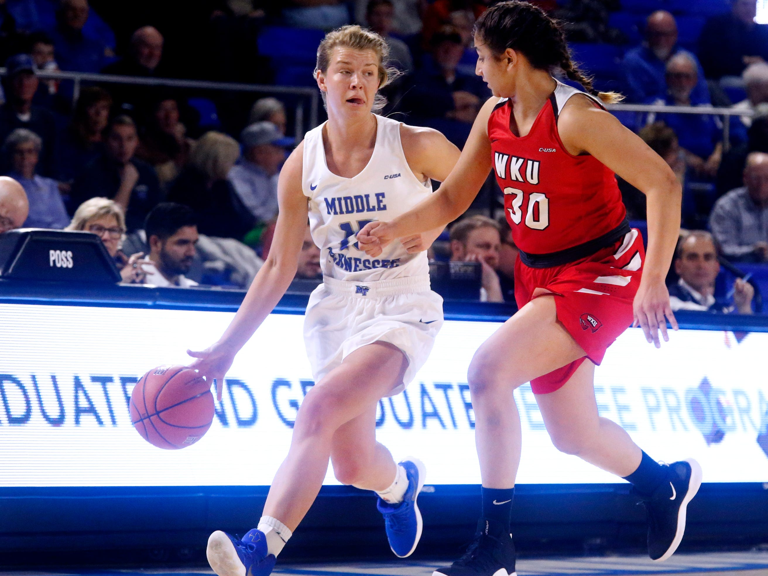 MTSU's guard Anna Jones (15) brings the ball up court as Western's guard Meral Abdelgawad (30) guards her on Thursday, Feb. 14, 2019.