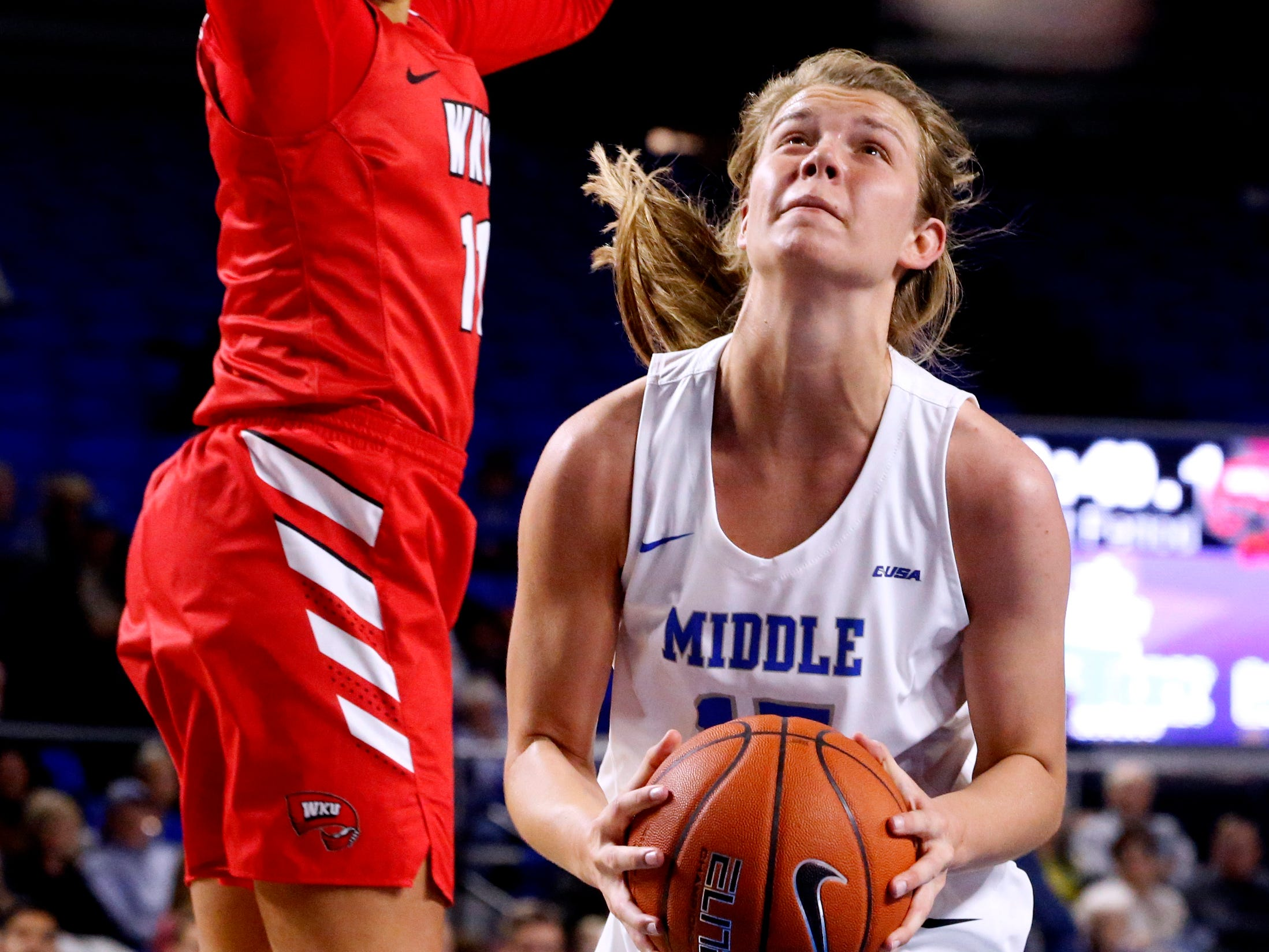 MTSU's guard Anna Jones (15) goes up for a shot as Western's guard Alexis Brewer (11) guards her on Thursday, Feb. 14, 2019.