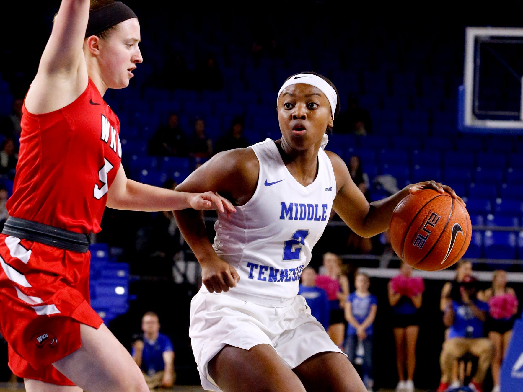 MTSU's guard Taylor Sutton (2) looks for a opening as Western's guard Whitney Creech (5) guards her on Thursday, Feb. 14, 2019.