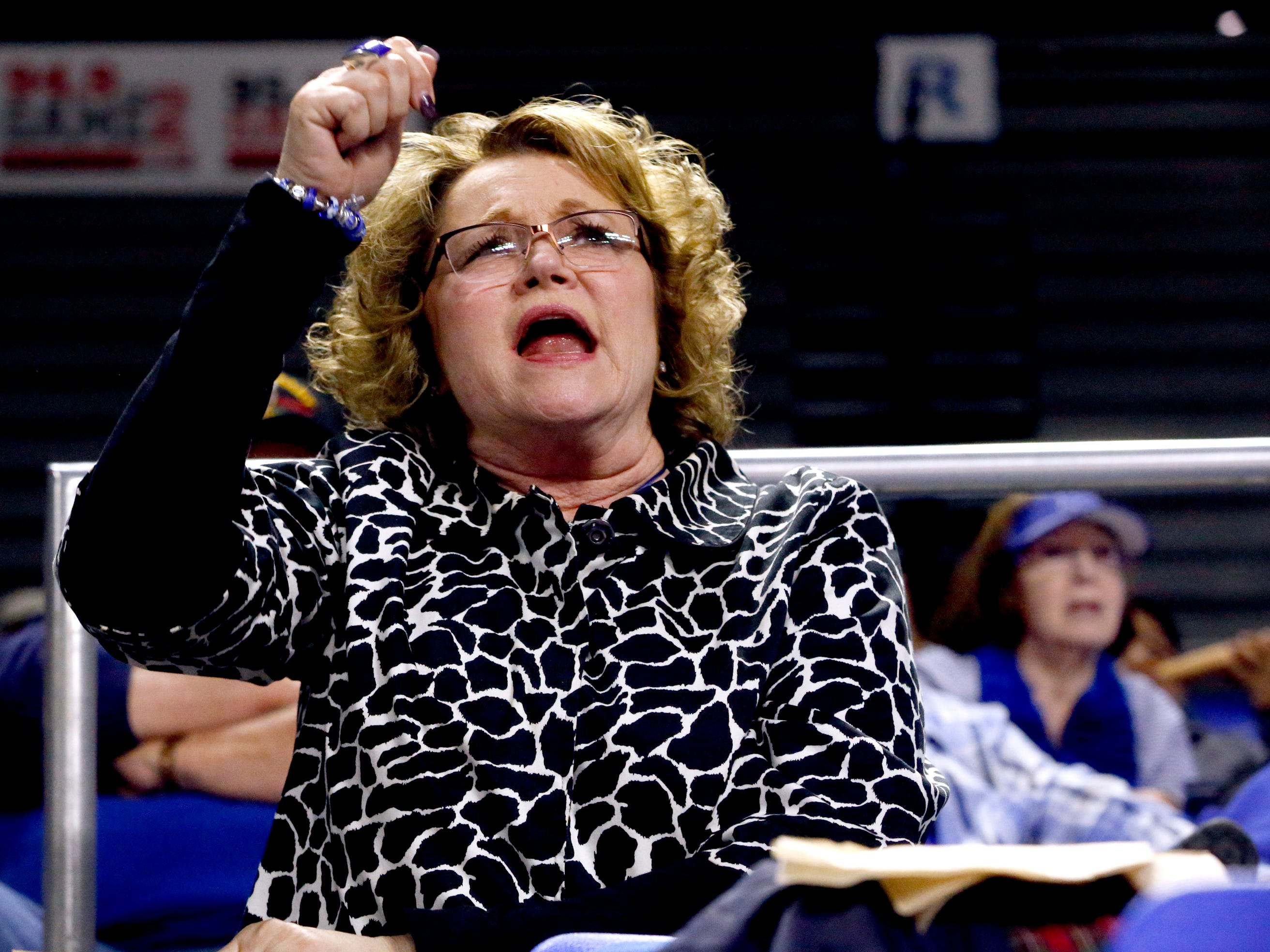 Deb Insell, the wife of MTSU's head coach Rick Insell, cheers MTSU women on from the stands on Thursday, Feb. 14, 2019, during the game against Western.