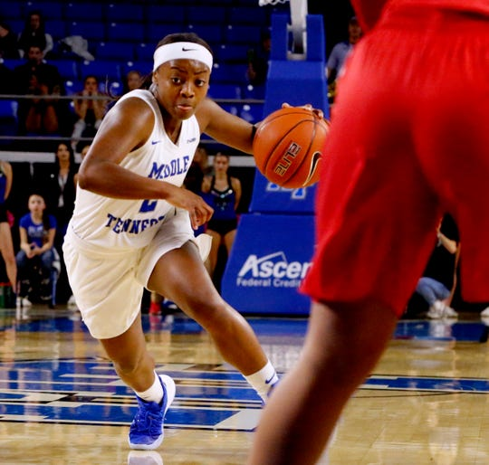 MTSU's guard Taylor Sutton (2) drives to the basket during the game against Western on Thursday, Feb. 14, 2019.